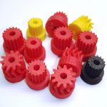 Various 3d printed gears in red, yellow and black