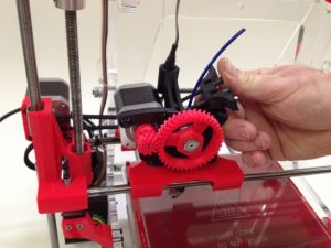 Flip open the quick release latch on a 3D printer
