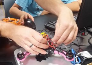 Helping students with their 3D printed drone kits.
