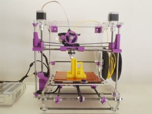 LAKERS 3d printer front view purple with yellow printed object