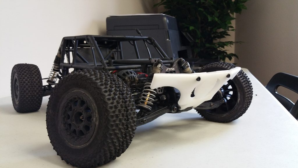 Axial EXO Terra Buggy with custom fabricated skid plate