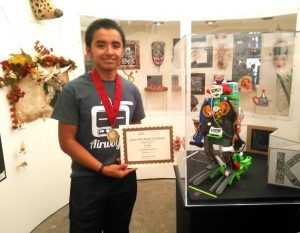 Jose Daniel Garcia ('Danny') a senior at Rancho Alamitos High School who won 1st Place in the Junior Art Exhibition for the Festival of Arts Pageant of the Masters .