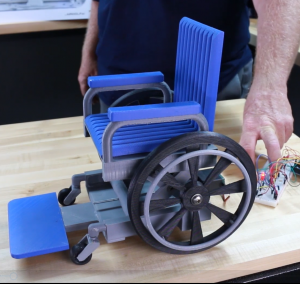 A model of the elevating wheelchair, an image of the Student 3D Printer Maker Challenge prototype by Anaheim High School students.