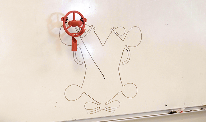 The Whiteboard Marker Plotter draws the William and Mary emblem.